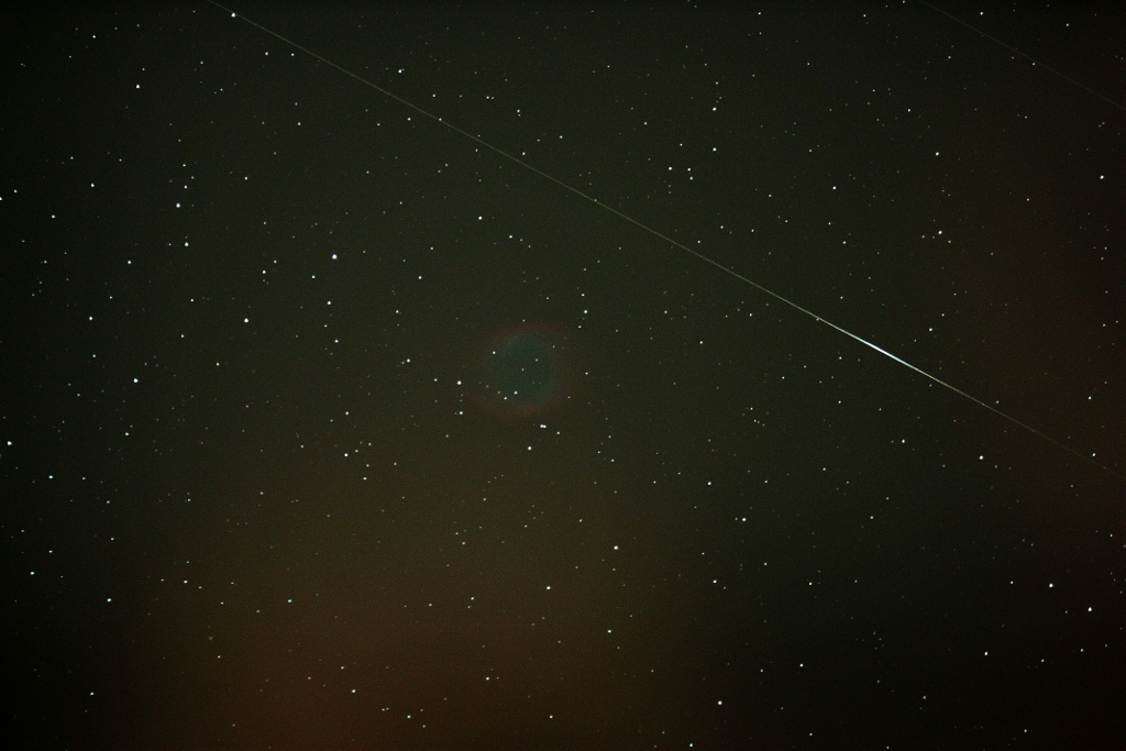 Iridium flare passing by the Helix Nebula.